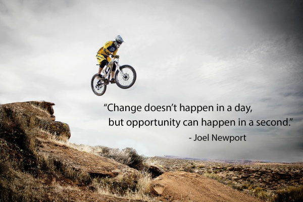 A person on a bmx Bike Jumping With a quote